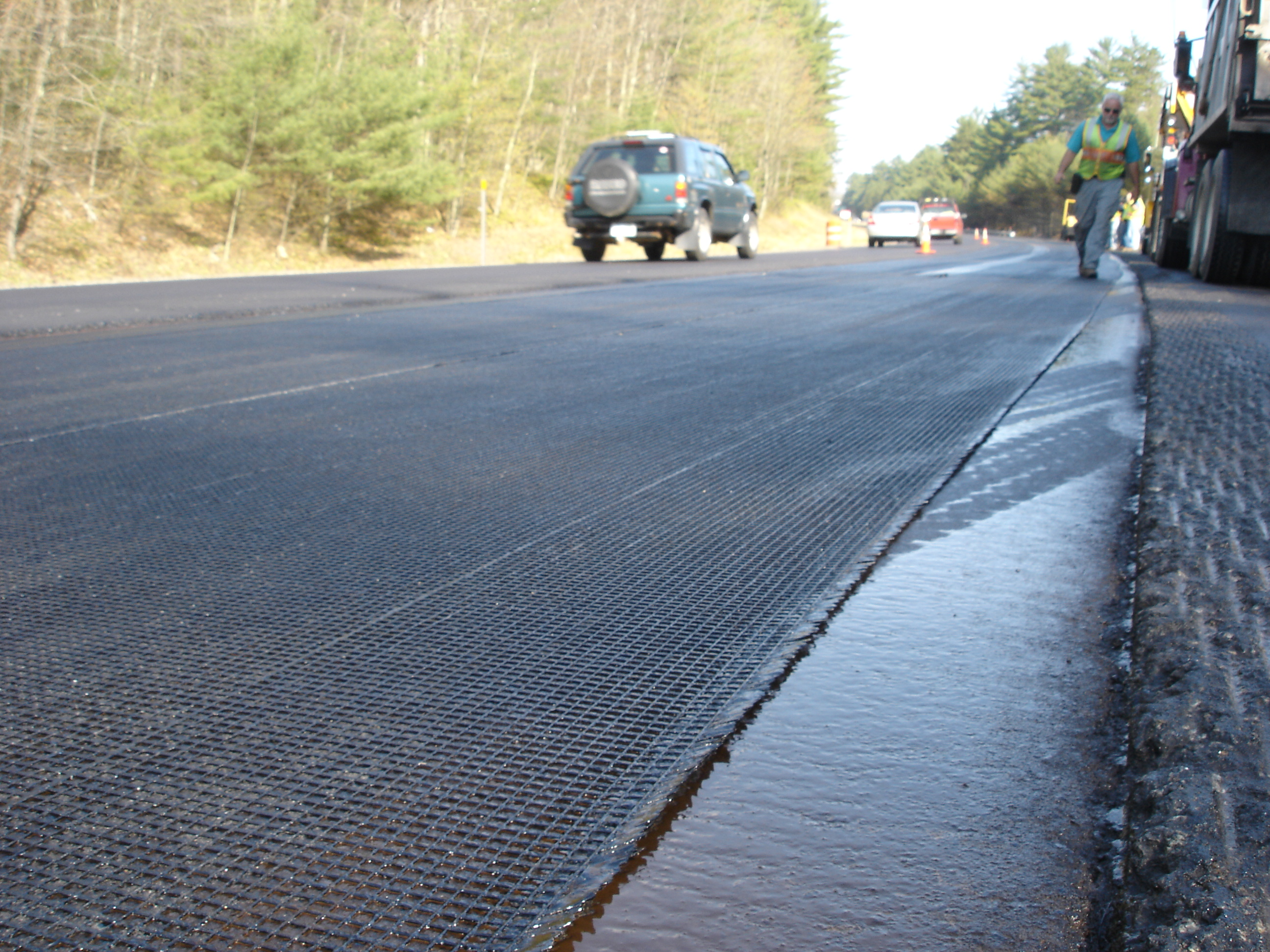 Interlayers: Asphalt Coatings vs. Elastomeric Coatings